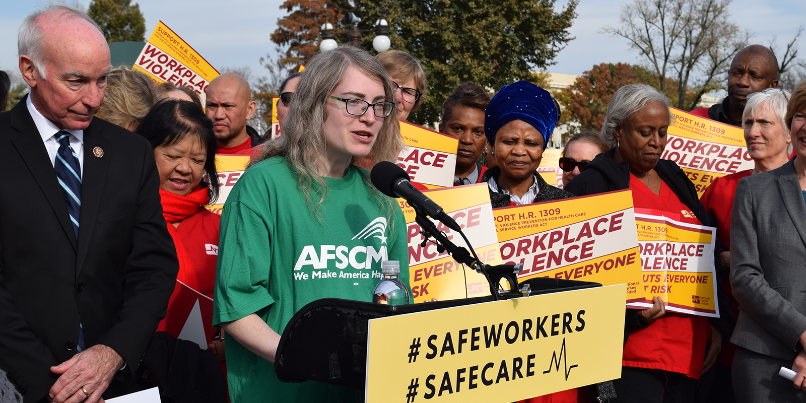 AFSCME member and social worker Miriam Doyle speaks at rally with Rep. Joe Courtney